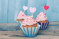 Cupcakes photo of on wooden background Royalty Free Stock Photography