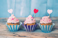 Cupcakes photo of on wooden background Royalty Free Stock Images