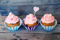 Cupcakes photo of on wooden background Royalty Free Stock Image