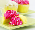 Cupcakes with Pink Icing and a Glass of Milk Stock Photo