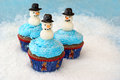 Cupcakes with snowmen Stock Photography