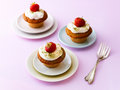 Cupcakes with strawberry and cream topping Stock Images