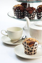 Cupcakes with tea three tiered tray and set Royalty Free Stock Photography