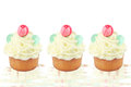Cupcakes three cream cupcake isolated on white Stock Image