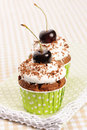 Cupcakes with whipped cream and cherry Stock Photography