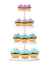 Cupcakes on a white stand four variations Stock Images