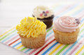 Cupcakes on a wooden table Stock Photography