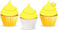 Cupcakes yellow cupcake set with icing in and white cases Stock Photo