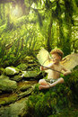 Cupid in  fantasy forest Stock Photo