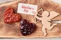Cupid and Valentine`s Day paper. Royalty Free Stock Photo