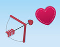 Cupids arrow heart aimed at large Royalty Free Stock Images