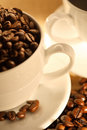 Cups of coffee, full of beans. Royalty Free Stock Photos
