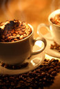 Cups of coffee, full of beans. Stock Image