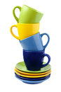 Cups on colorful saucers green yellow blue Stock Photo