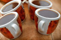 Cups with fresh coffee on table Royalty Free Stock Photography
