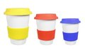 Cups with lids on white background Royalty Free Stock Image