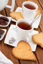 Cups of tea with cookies and chocolate Royalty Free Stock Images