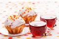 Cups tea two muffins Stock Photos