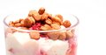 Curd cheese dessert with raspberries and small crunchies Stock Images