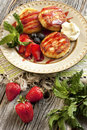 Curd pancakes with fresh berries and syrup cottage cheese pancake mint leaves decoration Stock Images