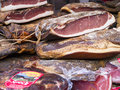 Cured ham on market at malcesine in northern italy is one of the lovely towns this lake lake garda is a popular european tourist Royalty Free Stock Photos