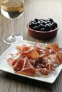 Cured iberian ham and olives tapas Stock Image