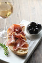 Cured iberian ham and olives tapas Stock Photo