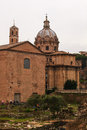 Curia iulia and the dome of the santi luca e martina rome view church in italy Stock Image