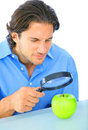 Curious Adult Examine Apple Stock Photography