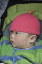 Curious asian baby cute asain in stroller Stock Image