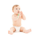 Curious baby brushing teeth bright picture of Stock Images