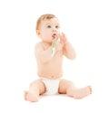 Curious baby brushing teeth Royalty Free Stock Photo
