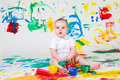 Curious baby playing with paints Royalty Free Stock Images