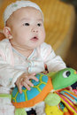 Curious baby with a toy Royalty Free Stock Images