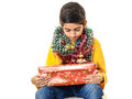 Curious boy with christmas presents or disappointed kid red box isolated on white background Royalty Free Stock Photography
