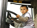 Curious boy at the wheel Royalty Free Stock Photo