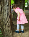 Curious child looking for bugs on a tree bark Royalty Free Stock Images