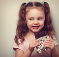 Curious cute kid girl eating dark chocolate and looking fun clo closeup vintage portrait Stock Photos