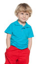 Curious little boy in blue shirt a portrait of a on the white background Royalty Free Stock Photos