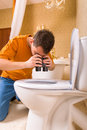 Curious man with binoculars looking in the toilet Royalty Free Stock Photo
