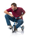 Curious man on a children s bicycle on white background Royalty Free Stock Photos