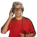 Curious man listening handsome mature with headphones on white background Royalty Free Stock Photography