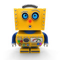 Curious toy robot leaning forward to look at something with shallow depth of field selective focus on the eyes Royalty Free Stock Photography
