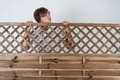 Curious young man behind the wooden fence Royalty Free Stock Images