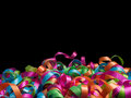 Curled coloured ribbons background a variety of and party Stock Photos