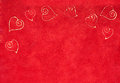 Curlicue hearts on a red background romantic delicate forming border textured with copyspace for your valentines wedding or Stock Photography