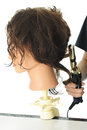 Curling the Practice Head's Hair Royalty Free Stock Photo