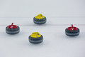 Curling stones for sports game of on ice Royalty Free Stock Image