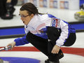 Curling women czech republic klára svatoňová of follows the stone at the ford world s championship march in saint john canada Royalty Free Stock Photos