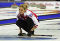 Curling women russia fomina watches rock s margarita follows her shot at the ford world s championship march in saint john canada Royalty Free Stock Photo